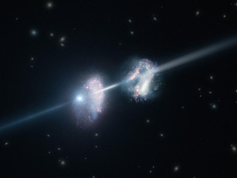 يُظهر هذا الشكل التصوّري مجرتين في الكون المبكِّر. الانفجار المذهل على اليسار، هو انفجار أشعة غاما ، وكيف يسافر الضوء الناتج عنه عبر المجرتين في طريقه نحو الأرض. (التُقطت الصورة بواسطة (ESO/L.Calçada