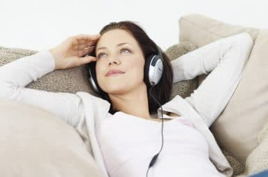 Young girl listening to music at home